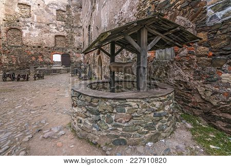 Old Well In The Courtyard Of The Ruins Of The Medieval Bolkow Castle In Lower Silesia, Poland