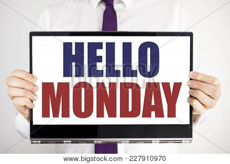 Word, Writing Hello Monday. Business Concept For Day Week Start Written On Tablet Laptop Holding By