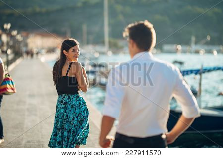 Shy Flirty Woman Smiling To A Man.man Giving A Compliment To A Introvert Passing Woman.receiving A C