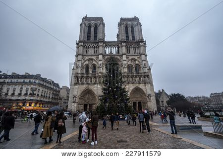 Paris, France - December 20, 2017:  Notre Dame De Paris Cathedral During A Cloudy Afternoon With The