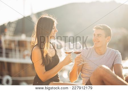 Romantic Couple Drinking Wine At Sunset.romance.two People Having A Romantic Evening With A Glass Of