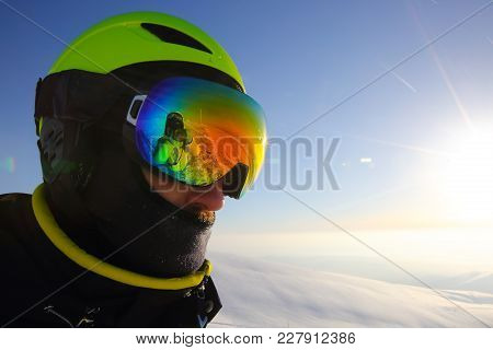 Skier In Goggles In Mountains