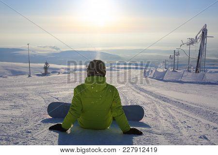 Snowboarder Sitting On Snow
