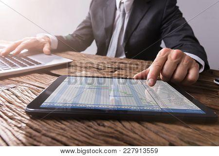 Businessman Working With Gantt Chart On Digital Tablet