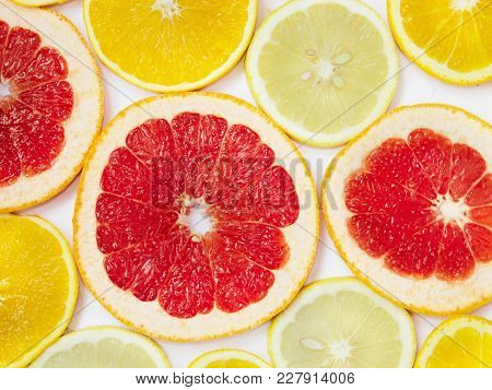 Citrus Pattern Of Orange Lemon And Grapefruit Slices. Different Citrus Fruits. Colored Citrus Patter