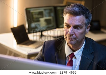 Close-up Of A Mature Businessman Working On Computer