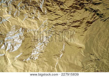Foil Abstract With Tones Of Gold And Yellow, As Well As Light And Dark Silver Reflections Shimmering