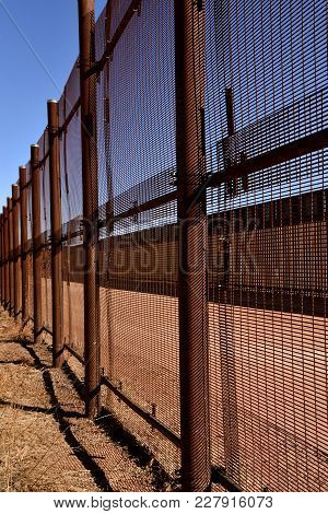 Two Chain Link Fences With Neutral Territory In The Middle Provide Barriers Between Mexico And Unite