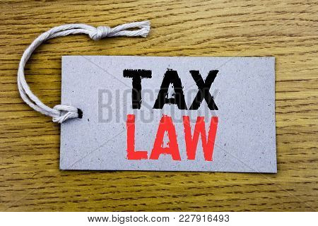 Conceptual Hand Writing Text Caption Showing Tax Law. Business Concept For Taxation Taxes Rule Writt