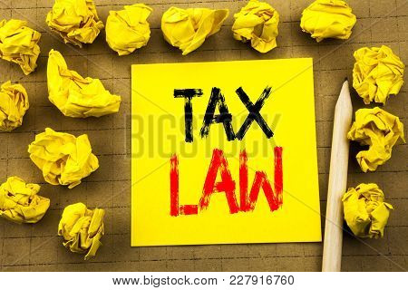 Tax Law. Business Concept For Taxation Taxes Rule Written On Sticky Note Paper On Vintage Background