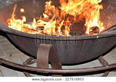 Angled Shot Of Outdoor Fire Pit With Flames