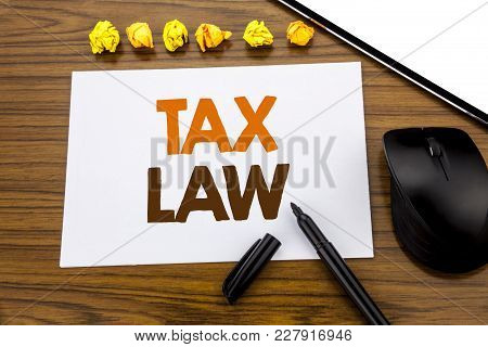 Conceptual Hand Writing Text Showing Tax Law. Business Concept For Taxation Taxes Rule Written On St