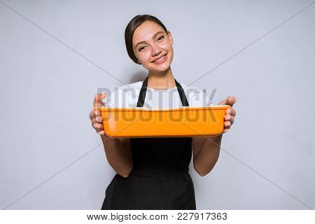Happy Young Woman Cook In Black Apron Prepared Delicious Food In Oven