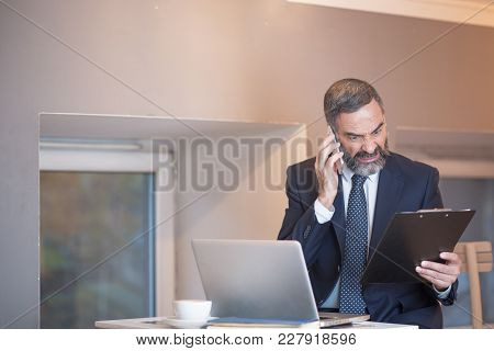 Angry Business Man Yelling At His Employee For A Mistake Made On Official Reports