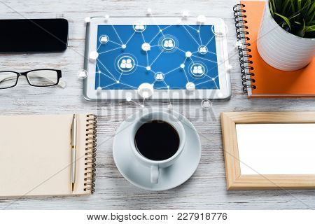 Top View Of Modern Workplace With Office Stuff And Social Network Connection Above Presenting Still