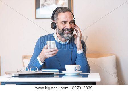 Senior Man Enjoying His Favorite Music
