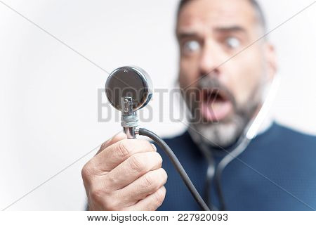 Senior Man Shocked And Outraged With His Blood Pressure Measurement Result, Studio Image