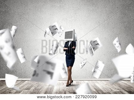Business Woman In Suit With Monitor Instead Of Head Keeping Arms Crossed While Standing Among Flying