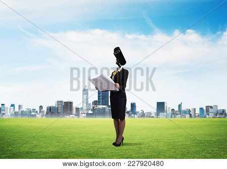 Elegant Businesswoman Outdoors With Papers In Hands And Camera Instead Of Head