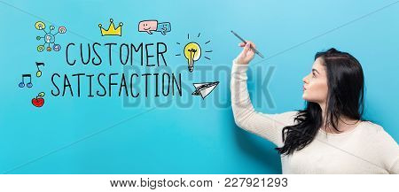Customer Satisfaction With Young Woman Holding A Pen On A Blue Background