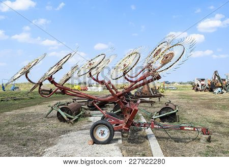 Tedder On Trailer For Tractor. The Machine For Gathering Hay.