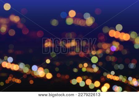 Blurred Light Bokeh Background. City Twillight Scene Background.
