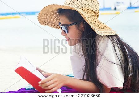 Summer Woman Relaxing In Hipster Beach Hat And Colorful Sunglasses. Funky Happy Girl Having Fun Duri