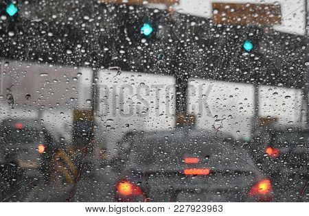 View Through The Windshield On The Road Checkpoint Motorway In The Rainy Season. Car Trouble In The