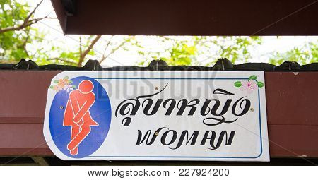 The Awesome Symbol Of Woman Toilet In Thai Language And English Language. It Expresses The Strong Fe