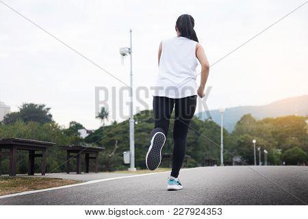 Running Man. Male Runner At Sprinting Speed Training For Marathon Outdoors
