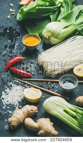 Asian Cuisine Ingredients Over Slate Stone Background. Vegetables, Spices, Shrimp, Rice, Sauces For