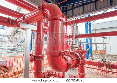 Red Pipeline Off Fire Pump House At Power Plant.