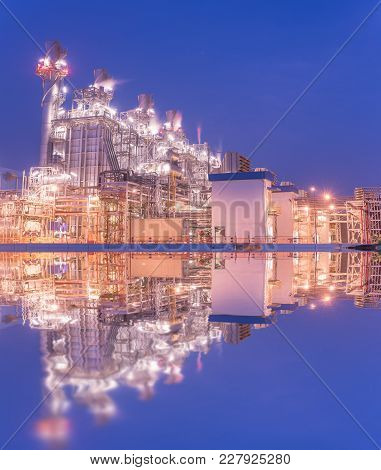 Natural Gas Combined Cycle Power Plant Reflection And Turbine Generator With Blue Sky.