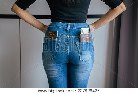Passport And Us Dollar And Boarding Pass In Jeans Pocket,close Up