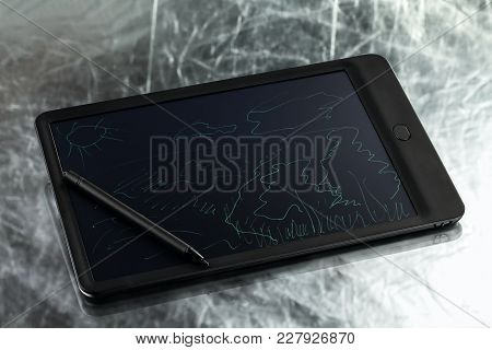 Graphic Tablet With Pen On Silvery Background