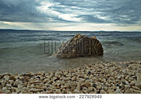 Soft Focus, Long Exposure Of Sea And Rock Beach/ Panoramic View From The Beach At The Blue Hour
