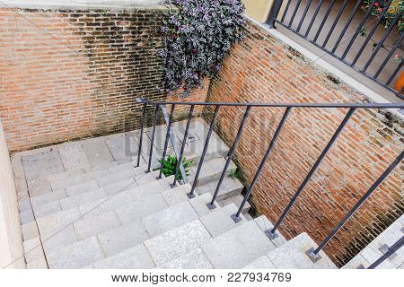 Old Stairs Way And Red Brick Wall At Vintage Home., Down Stair
