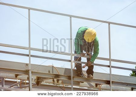 In The Construction Site, The Welding Workers At Work., Worker Weld Metal In Factory And Sparks