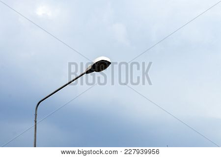 Lamp On Street With Cloud Sky. Twilight Time, Lamp Save Energy., Closing Light, For Save Energy., Li
