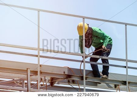 A Construction Workers Installing Beam Formwork. Formwork Is Located At The High Level That Requires