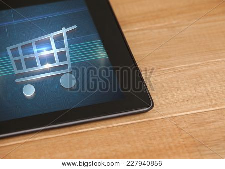 Digital composite of Tablet with Shopping trolley icon