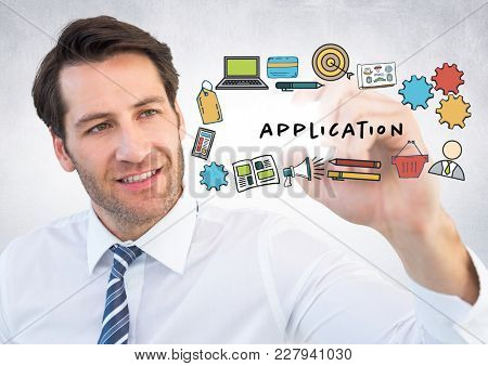 Digital composite of Business man with marker behind application doodles and flare against white wall