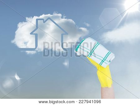 Digital composite of Hand with cloth cleaning the sky. With cloud house