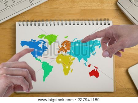 Digital composite of Hands pointing at America and Russia on Colorful Map on a notepad