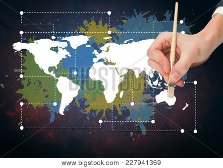 Digital composite of Hand painting a Colorful Map with paint splatters on wall background