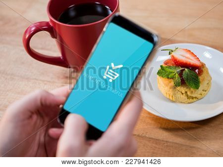 Digital composite of Person using Phone with Shopping trolley icon