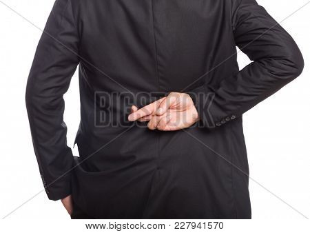 Digital composite of Business men with one hand on the pocket and the other with fingers crossed