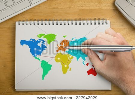 Digital composite of Hand writing with pen on Colorful Map on a notepad