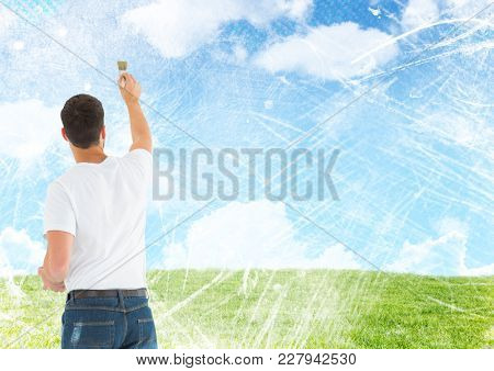 Digital composite of Man painting blue sky clouds