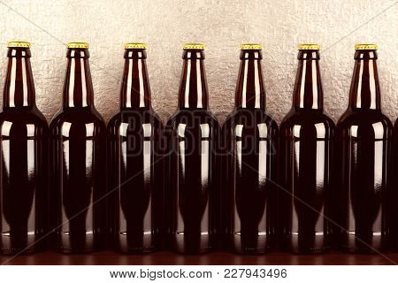 Bottles of beer on wooden table